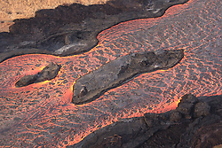 Handout photo of lava flows around islands in the lava channel. The direction of flow is from the upper right to lower left. Field crews can make a rough calculation of velocity by timing large blocks as they pass between two landmarks that are a known distance apart. Kilauea Volcano, HI, USA, June 30, 2018. Photo by USGS via ABACAPRESS.COM