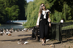 © Licensed to London News Pictures. 14/06/2021. London, UK. Visitors to St James' Park enjoy the morning sunshine in central London. Another day of high temperatures is expected in the UK. Photo credit: Peter Macdiarmid/LNP