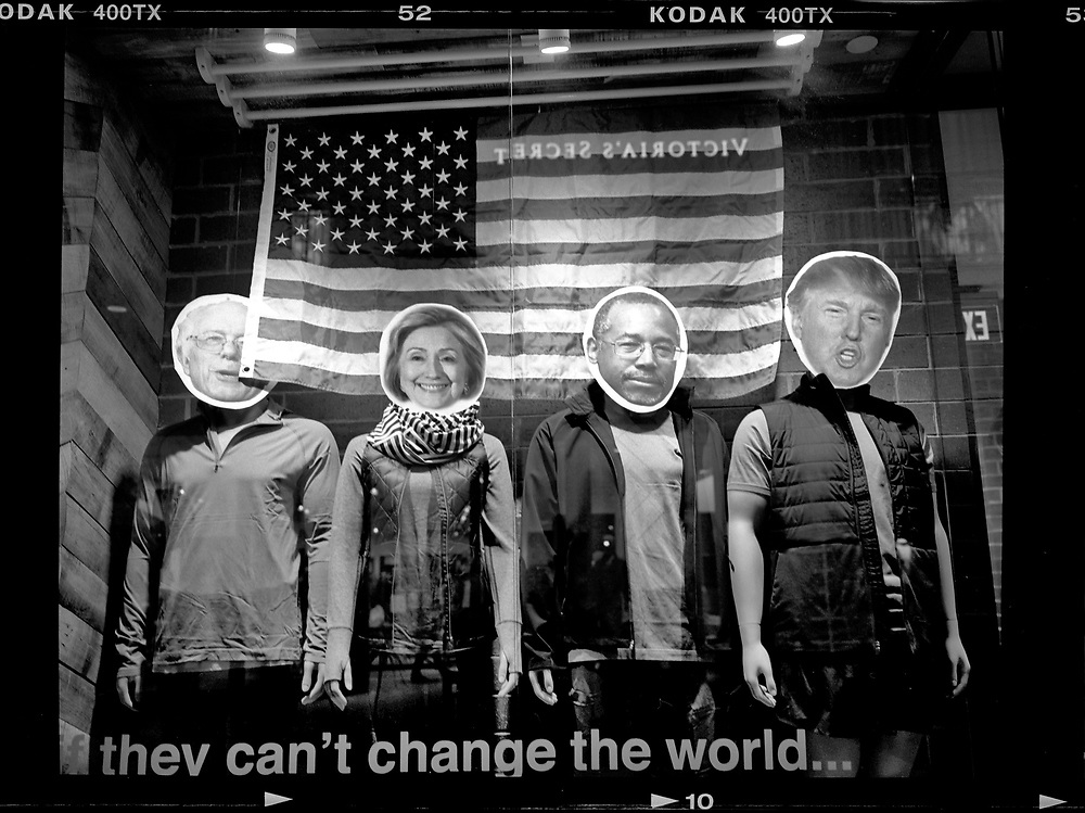 The photographs of U.S. Presidential candidates Bernie Sanders, Hillary Clinton, Ben Carson, and Donald Trump are placed on the bodies of mannequins in a store window in West Des Moines, Iowa.  © Photo by Jim Young