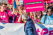 Sadiq Khan high fives the young people who will lead the march - The People's Vote March For The Future demanding a Vote on any Brexit deal. The protest assembled on Park Lane and then marched to Parliament Square for speeches.