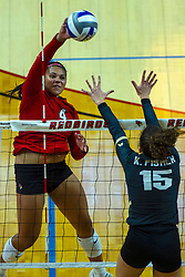 BLOOMINGTON, IL - September 14: Kaylee Martin strikes to Kristina Fisher during a college Women's volleyball match between the ISU Redbirds and the University of Central Florida (UCF) Knights on September 14 2019 at Illinois State University in Normal, IL. (Photo by Alan Look)