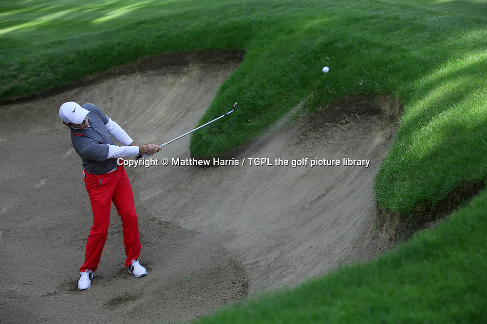 Rory MCILROY (NIR) 3rd shot from green side bunker at 18th par 5 during fourth round BMW PGA Championship 2014,Wentworth West,Wentworth,Virginia Water,Surrey,England.