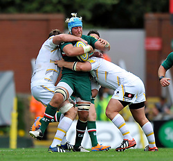 Leicester Tigers number 8 Jordan Crane is double-tackled in possession - Photo mandatory by-line: Patrick Khachfe/JMP - Tel: Mobile: 07966 386802 - 08/09/2013 - SPORT - RUGBY UNION - Welford Road Stadium - Leicester Tigers v Worcester Warriors - Aviva Premiership.