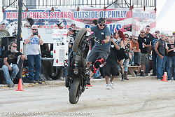 Cole Freeman of the Ill Conduct stunt team performing at the new Full Throttle Saloon on highway 79 (the old Broken Spoke) during the annual Sturgis Black Hills Motorcycle Rally.  SD, USA.  August 9, 2016.  Photography ©2016 Michael Lichter.