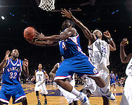 Kansas guard Sherron Collins (4) drives by Kansas State forward Cartier Martin (20) in the first half at Bramlage Coliseum in Manhattan, Kansas, February 19, 2007.  K-State lead the Jayhawks at halftime 30-29.
