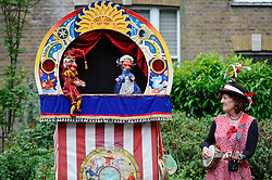 © Licensed to London News Pictures. 13/05/2018. LONDON, UK. A performance takes place at the Covent Garden May Fayre at St Paul's Church, Bedford Street, known as the actors' church.  Now in its 43rd year, Punch and Judy professors and puppeteers celebrate the art of puppetry on Mr Punch's 356th birthday, near to where writer Samuel Pepys first saw Mr Punch in May 1662.  Photo credit: Stephen Chung/LNP