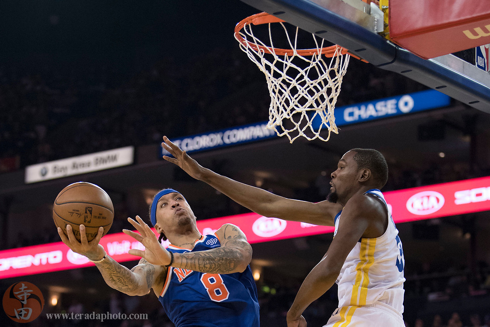 January 23, 2018; Oakland, CA, USA; New York Knicks forward Michael Beasley (8) shoots the basketball against Golden State Warriors forward Kevin Durant (35) during the second quarter at Oracle Arena.