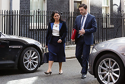 © Licensed to London News Pictures. 12/04/2016. London, UK. PRITI PATEL and STEPHEN CRABB leave a cabinet meeting at 10 Downing Street. Photo credit : Vickie Flores/LNP