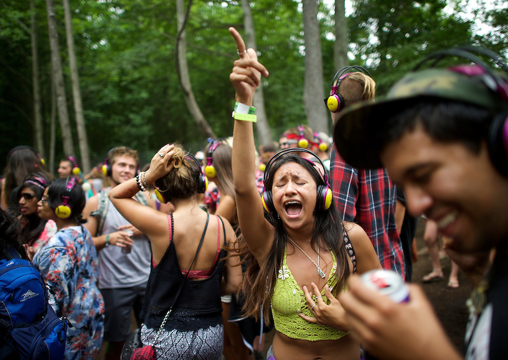 Revelers dance at the silent disco during the Firefly Music Festival in Dover, DE on June 21, 2014.  The four day festival is set at a 105 acre grounds at the Dover International Speedway and many well known bands perform.