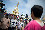 Chinese pilgrims take pictures at the temple on the top of the Buddhist Sacred Mountain on Emei Shan  (Chinese: 峨眉山市 ; pinyin: Éméishānshì) in Emei, near Chengdu China, August 13, 2014.<br /> <br /> Confucianism, Taoism and Buddhism are the three major religions in China. Temples and statues witness their ancient roots all over the Chinese country.<br /> <br /> © Giorgio Perottino