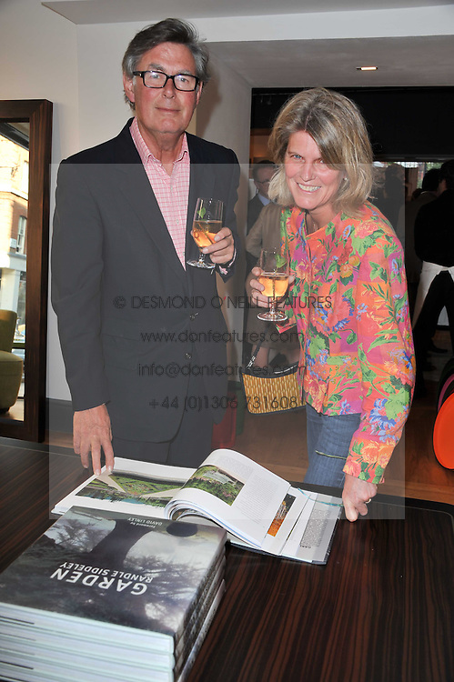 DAVID & SARAH CRAIG at a party to celebrate the publication of 'Garden' by Randle Siddeley held at Linley, 60 Pimlico Road, London on 24th May 2011.