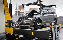 © Licensed to London News Pictures. 14/07/2019. London, UK. A damaged BMW X5 car is removed in Battersea, south west London after a car was driven into a group of people leaving a hotel. Three men have been arrested on suspicion of murder after the incident which took place at 11. 15pm on Saturday night. One man has a broken leg and six other people also sustained minor injuries. Photo credit: Peter Macdiarmid/LNP