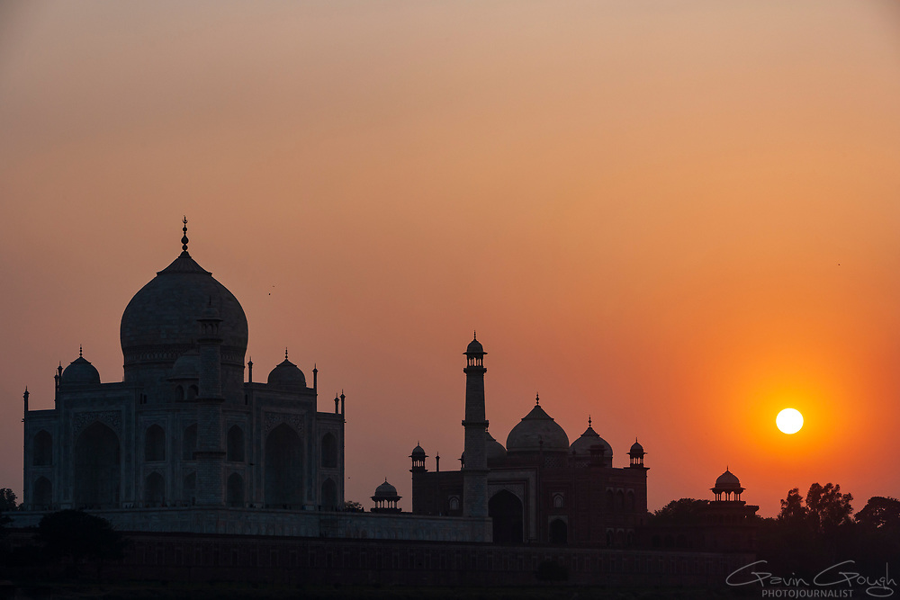 Silhouette of the iconic towers and dome at sunset, Taj Mahal, Agra, India