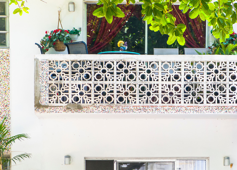 A Miami Modern (MiMo) style masonry balcony railing and tilework on a small apartment house in Miami Beach