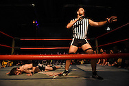 """Referee Drew Gulak mugs for the crowd as Chuck O'Neil lays on the floor of the ring after a bout at the Beyond Wrestling Organization's """"Dream Left Behind"""" event, held at the Center for Arts at the Armory in Somerville, Sunday, Jan. 31, 2016."""