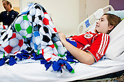 30 DECEMBER 2009 -- PHOENIX, AZ: Mackenzie Saunders (CQ) in her bed at St. Joseph's Hospital in Phoenix Wednesday. Mackenzie was knocked down by another player during a soccer game. She finished the game but later in the day her legs started hurting and her parents took her to a hospital. Three hospitals later, she was in St. Joseph's with a diagnosis of a swollen spine and she couldn't walk. Now she's in physical therapy. She is expected to make a full recovery but her doctors have said she won't be able to play soccer for at least another 16 months.  Photo by Jack Kurtz