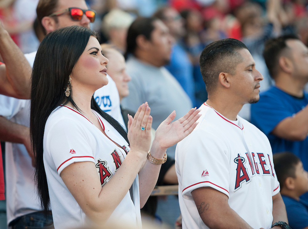 Fans cheer during the Angels' 8-1 victory over the Dodgers Wednesday night at Angel Stadium.<br /> <br /> ///ADDITIONAL INFO:   <br /> <br /> angels.0519.kjs  ---  Photo by KEVIN SULLIVAN / Orange County Register  -- 5/18/16<br /> <br /> The Los Angeles Angels take on the Los Angeles Dodgers in inter-league play at Angel Stadium Wednesday night.