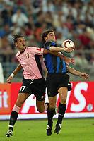 Bari 3/8/2004 Trofeo Birra Moretti - Juventus Inter Palermo. <br /> <br /> Leandro Rinaudo Palermo challenges Gonzalo Sorondo Inter<br /> <br /> Risultati / results (gare da 45 min. each game 45 min.) <br /> <br /> Juventus - Inter 1-0 Palermo - Inter 2-1 Juventus b. Palermo dopo/after shoot out <br /> <br /> Photo Andrea Staccioli