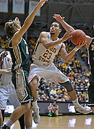 WICHITA, KS - NOVEMBER 14:  Guard Fred VanVleet of the Wichita State Shockers drives to the basket against forward Tim Rusthoven #22 of the William & Mary Tribe during the first half on November 14, 2013 at Charles Koch Arena in Wichita, Kansas.  (Photo by Peter Aiken/Getty Images) *** Local Caption *** Fred VanVleet;Tim Rusthoven