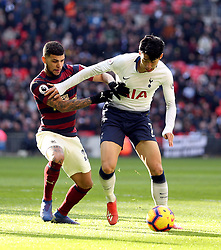 Newcastle United's DeAndre Yedlin (left) and Tottenham Hotspur's Son Heung-min battle for the ball during the Premier League match at Wembley Stadium, London.