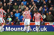 Marko Arnautovic of Stoke City © celebrates with his teammates after scoring his teams 1st goal. Barclays Premier league match, Stoke city v Manchester city at the Britannia Stadium in Stoke on Trent, Staffs on Saturday 5th December 2015.<br /> pic by Chris Stading, Andrew Orchard sports photography.