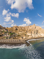 Aerial view of beach with rock formation on Santorini island, Greece.