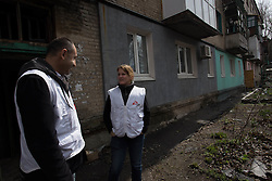 Natalie Roberts - Emergency Coordinator for MSF in Debalsevo and Doctor Khachatur Malakyanon whilst out on a home visit to a patient.