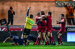 Scarlets' Paul Asquith celebrates scoring his sides first try with team-mates<br /> <br /> Photographer Craig Thomas/Replay Images<br /> <br /> Guinness PRO14 Round 17 - Scarlets v Leinster - Friday 9th March 2018 - Parc Y Scarlets - Llanelli<br /> <br /> World Copyright © Replay Images . All rights reserved. info@replayimages.co.uk - http://replayimages.co.uk