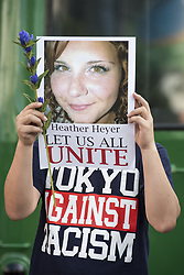 August 27, 2017 - Tokyo, Japan - A participant holds a photo of Heather Heyer during the standing silent appeal, a hundred people gathered in Shibuya against racism and violence in memory of Heyer under the slogan ''Let us all unite.''Heather Heyer died on August 12, 2017 when a car rammed into a group of people protesting against a white supremacist rally in Charlottesville, Virginia. (Credit Image: © Alessandro Di Ciommo/NurPhoto via ZUMA Press)