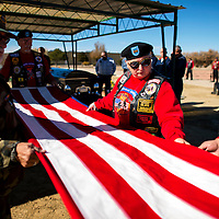 111213    Brian Leddy<br /> Mary Kramber and Lionel Gutierrez help fold a flag during the funeral of Harry Botkin Tuesday. The two are part of the Vets Helping Vets organization, which makes sure local veterans receive proper honors during burial.