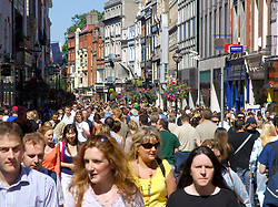 Crowds of people on famous Grafton Street in Dublin Ireland