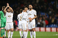 Kyle Bartley of Swansea City and Ki Sung-Yueng of Swansea City share a joke after the final whistle. Barclays Premier League match, Crystal Palace v Swansea city at Selhurst Park in London on Monday 28th December 2015.<br /> pic by John Patrick Fletcher, Andrew Orchard sports photography.