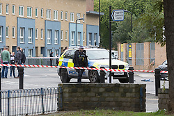 © Licensed to London News Pictures. 15/10/2015. London, UK. Police at the scene of a shooting in Haggerston, Hackney on the corner of Lovelace Street and Haggerston Road. Photo credit : Vickie Flores/LNP