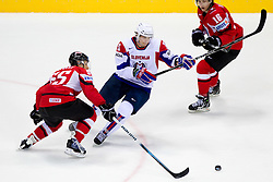 Blaz Gregorc of Slovenia between Robert Lukas of Austria and Patrick Harand of Austria during ice-hockey match between Austria and Slovenia of Group G in Relegation Round of IIHF 2011 World Championship Slovakia, on May 7, 2011 in Orange Arena, Bratislava, Slovakia. Austria defeated Slovenia 3-2. (Photo By Vid Ponikvar / Sportida.com)