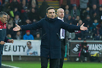 Football - 2017 / 2018 Premier League - Swansea City vs. Burnley<br /> <br /> Swansea City manager Carlos Carvalhal on the touchline, arms outstretched, , at The Liberty Stadium.<br /> <br /> COLORSPORT/WINSTON BYNORTH