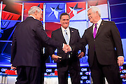 "22 FEBRUARY 2012 - MESA, AZ:  Congressman RON PAUL (left) shakes hands with Governor MITT ROMNEY and Congressman NEWT GINGRICH at the Arizona Republican Presidential Debate in the Mesa Arts Center in Mesa, AZ, Wednesday. It is the last debate before the Michigan and Arizona Republican primaries on Feb. 28 and ""Super Tuesday"" on March 6. PHOTO BY JACK KURTZ"