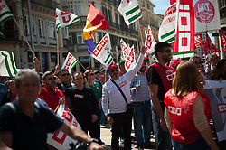 May 1, 2019 - Malaga, MALAGA, Spain - Protesters are seen waving flags during the Labour Day demonstration..Thousands of people called by the General Workers Union (UGT), and the labour union 'Comisiones Obreras' (CCOO), protest in Malaga during a nationwide demonstration in favour of the workers' rights and decent employments under the slogan: ''The battle continues, more rights, equality and cohesion, People first. (Credit Image: © Jesus Merida/SOPA Images via ZUMA Wire)