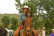 Cowgirl on mule (Mulus mula) at Montana Mule Days, Drummond, Montana, <br /> MODEL RELEASED