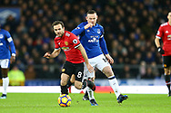 Juan Mata of Manchester United gets away from Wayne Rooney of Everton. Premier league match, Everton v Manchester Utd at Goodison Park in Liverpool, Merseyside on New Years Day, Monday 1st January 2018.<br /> pic by Chris Stading, Andrew Orchard sports photography.