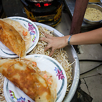 Quán Bánh Xèo 46A, a restaurant specializing in bánh xèo in Ho Chi Minh City, also known as Saigon, Vietnam. Bánh xèo is a crisp rice-flour crêpe filled with pork, shrimp, and bean sprouts and eaten with fresh herbs.