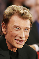 File photo : Singer Johnny Hallyday during the taping of Michel Drucker's talk show Vivement Dimanche on December 1, 2004 at the Studio Gabriel in Paris, France. France's biggest rock star Johnny Hallyday has died from lung cancer, his wife says. He was 74. The singer - real name Jean-Philippe Smet - sold about 100 million records and starred in a number of films. Photo by ABACAPRESS.COM