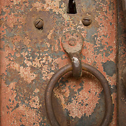 Rusted Door in Jacksonville, Oregon with an old style ring handle and keyhole.