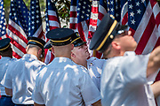 """The US Army color guard prepares the flag backdrop for the """"Celebration of America"""" event on the South Lawn of the White House on June 5, 2018 in Washington, DC. The celebration is being staged as a replacement for a White House visit by the Super Bowl champion Philadelphia Eagles. Some of the team was planning on boycotting the event due to the President's stance on players kneeling during the National Anthem at NFL games, so Trump resented their invitation.      Photo by Pete Marovich/UPI"""
