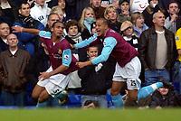 Photo: Daniel Hambury.<br />Tottenham Hotspur v West Ham Utd. The Barclays Premiership. 20/11/2005.<br />West Ham's Anton Ferdinand celebrates his goal with Bobby Zamora.