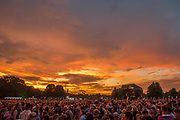 The sun sets over teh Obelisk Stage as Mumford and Sons start their set -  on Saturday evening - The 2017 Latitude Festival, Henham Park. Suffolk 15 July 2017