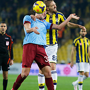 Fenerbahce's Caner Erkin (R) and Trabzonspor's Salih Dursun (F) during their Turkish superleague soccer derby Fenerbahce between Trabzonspor at the Sukru Saracaoglu stadium in Istanbul Turkey on Saturday 07 February 2015. Photo by Aykut AKICI/TURKPIX