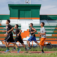 080113       Cable Hoover<br /> <br /> The Wingate Bears cross country team warms up with a few laps around the track during practice at Wingate High School Wednesday.
