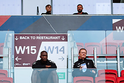 Bristol City's Kalifa Cisse and New assistant Head Coach Keith Downing watch from the stand - Rogan/JMP - 21/08/2020 - Ashton Gate Stadium - Bristol, England - Bristol City v Cheltenham Town - Pre Season Friendly.