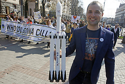 April 14, 2018 - Kiev, Ukraine - A protester carries a model of SpaceX's Falcon Heavy rocket during a costumed march-performance ''March For Science'' in center of Kiev, Ukraine, on 14 April 2018. Popularizers of science, physicists and adherents of science took part in the global action ''March For Science'' for the liberty of research and teaching, during the rallies, that took place around the world on Saturday  (Credit Image: © Serg Glovny via ZUMA Wire)