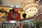 Antiques display inside famous historic Los Gatos Cervecerias bar, Madrid city centre, Spain